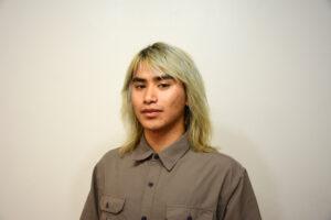 Anthony Le, Bboy Chopz, School of Breaking Instructor headshot with grey background.