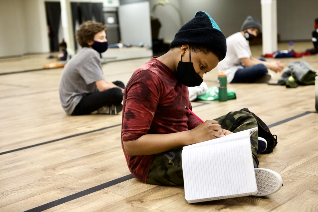 Hip Hop Dance Student in Face mask Taking Notes