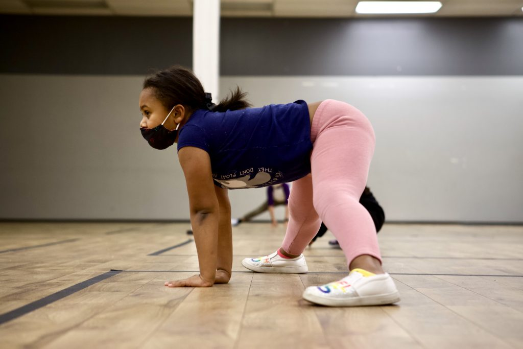 Hip Hop Dance Student in Face mask Stretching